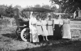 Automobile, Eberhardt family women beside car