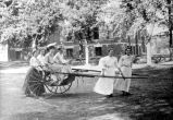 Entertainment, Girls in park pulling cart