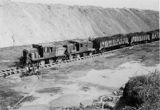 Train hauling coal, strip mining