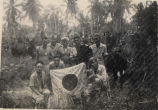 Soldiers with a captured Japanese Flag