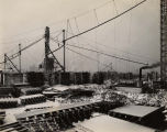 Field Museum construction site photograph --western view of the lumber stockpiles used in...