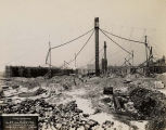 Field Museum construction site photograph lumber stockpiles with cranes for pouring cement in...