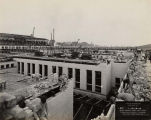 Field Museum construction site photograph of workers laying brick, dated 4-19-1918