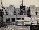 Field Museum construction site photograph -- view of stockpiles of marble facing tiles with...