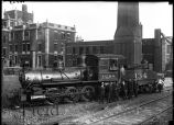 Men and train engine, possibly outside Illinois Central railroad terminal