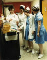 1980.1.8 Graham Hospital School of Nursing Instructor and Students with ICU Nurse