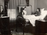 1943.1.7 Graham Hospital School of Nursing student caring for patient