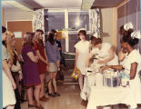 1973.23.8 Graham Hospital School of Nursing career day maternity display
