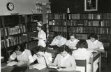 1953.1.10 Graham Hospital School of Nursing Students and Instructor in the Library