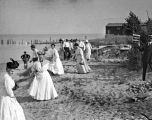 Highland Park beach event : 15 Women in Hats, Man displaying box of Kennedy's Biscuits