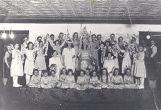 Photo of a group of children during a Itasca Public School Pageant.