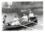 Exploring Diamond Lake in a rented rowboat, 1913.  91.17.106