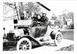 Ford car with John Hodge, Ruth Ray Hodge, and daughters Harriet, Esther, and Ruthie, 1914. ...