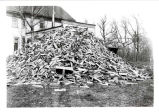 Wood pile on George Ray farm, 1917.  91.17.42