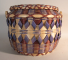 Winnebago larger sized woven basket with handle (1991)