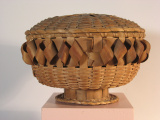 Iroquois Woven split ash circular work basket on pedestal