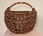 Ojibwa small melon basket with handle (Date Unknown)