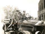 William Busse and Herman F. Meyn in Firetruck
