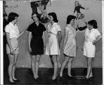 Elgin Community College women model gym suits in April 1950 photograph