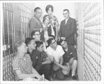 School Board Member with students in bank vault