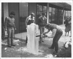 Scott Erwin ice sculpting outside A Building