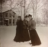 Students standing in snow in front of Senior House, Ferry Hall, 1890s