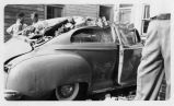 Tornado damage to a new Dodge car, N. 2nd St., 1948
