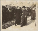 A priest walks with Cardinal Mundelein