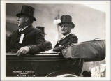 Dignitaries in an open car