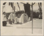 Cardinal Bonzano bows at the altar