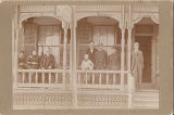 Group on Porch of Mrs. E. Bastian's Boarding House
