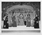 Eureka Pumpkin Festival Queen and attendants standing on festival stage before coronation, 1949.