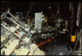 Book cases, books, and a wall damaged as a result of the April 19, 1989 firebombing of the Joliet...