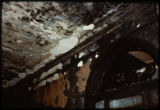 A portion of a wall and ceiling damaged in the April 19, 1989 firebombing of the Joliet Public...