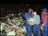 Volunteers removing books damaged in the April 19, 1989 firebombing of the Joliet Public Library.