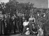 Group of People in Front of a Garden