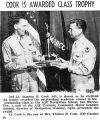 """Cook Is Awarded Class Trophy"" (Photograph)"