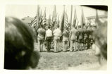 Men holding flags at the dedication for the American Legion Post home on June 12, 1927