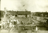 Photograph of Hinkley pool looking towards a field house and flag circa 1929