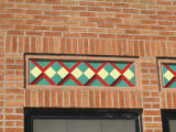 Photograph of tiles above a window on the Theodore Roosevelt Elementary School in Park Ridge,...
