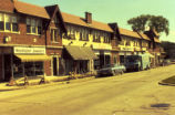 Slide photograph of Wieshuber Jewelers and other businesses on Devon Avenue in Park Ridge, Illinois