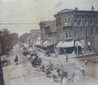 Parades, Sterling, Illinois, Horse & wagons passing E. 3rd Street & Locust Street,...