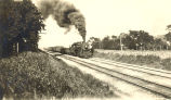 Railroads, Sterling, Illinois, Steam engine & freight cars traveling on tracks, smoke billowing