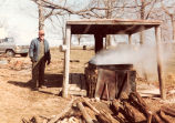 Photograph of Ed Wesley making syrup for Boy Scouts in 1982