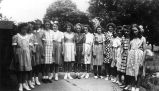Photograph of Towanda Girls 4-H Club members modeling dresses and skirts they made