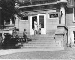 Carnegie Library of Wilmette front steps with patrons.