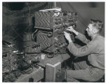 Carl Mayfield Operating Radio at Yakima Washington