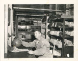 Sgt. Ballo in charge of Athletic Equipment at the Post Gymnasium.